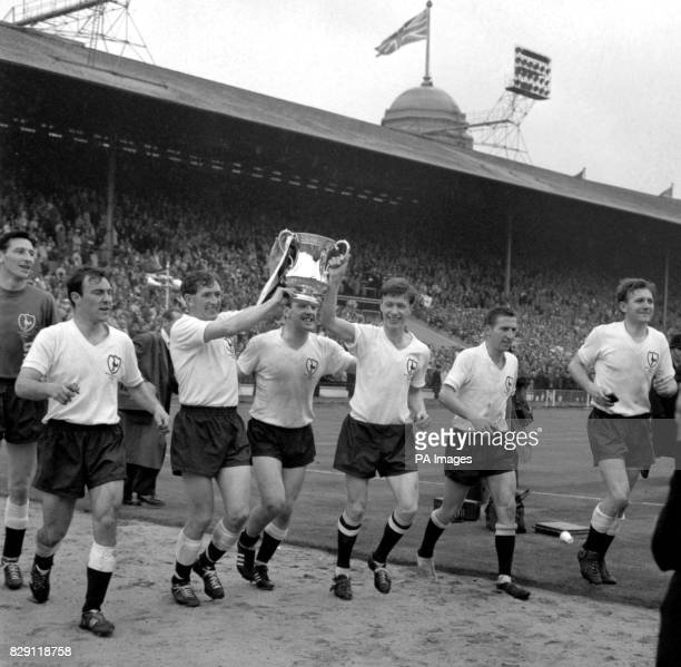 It's theirs for the second year in succession and happy Tottenham Hotspur players hold the FA Cup aloft as they trot around the ground in a lap of...