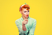 It's you! Portrait angry annoyed pin up retro style woman getting mad pointing finger at you camera showing hand gesture this is you, you chosen, isolated on yellow wall background.  Negative emotions