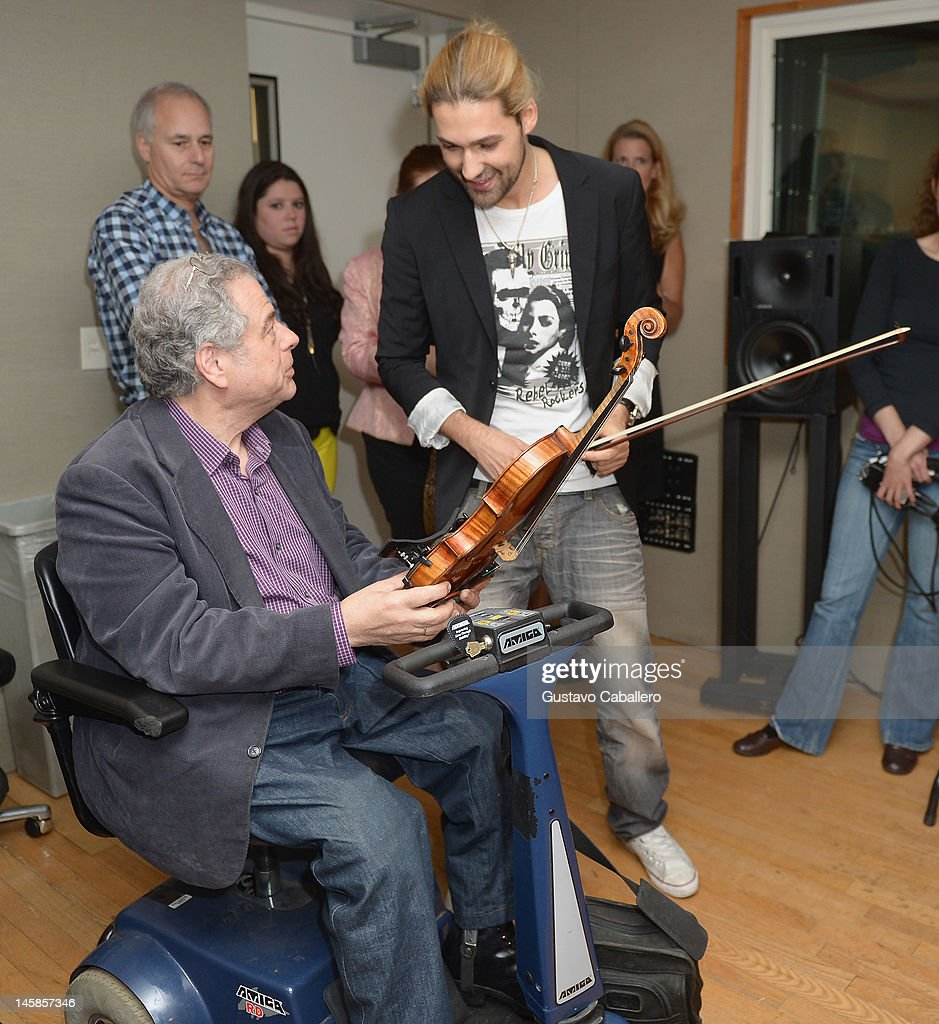 <a gi-track='captionPersonalityLinkClicked' href=/galleries/search?phrase=Itzhak+Perlman&family=editorial&specificpeople=593397 ng-click='$event.stopPropagation()'>Itzhak Perlman</a> and <a gi-track='captionPersonalityLinkClicked' href=/galleries/search?phrase=David+Garrett&family=editorial&specificpeople=4603343 ng-click='$event.stopPropagation()'>David Garrett</a> are seen as part of SiriusXM's 'Artist Confidential' series on SiriusXM Pops with special guest <a gi-track='captionPersonalityLinkClicked' href=/galleries/search?phrase=Itzhak+Perlman&family=editorial&specificpeople=593397 ng-click='$event.stopPropagation()'>Itzhak Perlman</a> on June 6, 2012 in New York City.