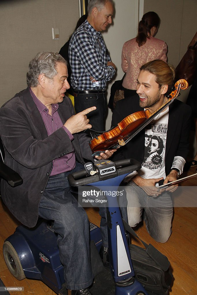 <a gi-track='captionPersonalityLinkClicked' href=/galleries/search?phrase=Itzhak+Perlman&family=editorial&specificpeople=593397 ng-click='$event.stopPropagation()'>Itzhak Perlman</a> and <a gi-track='captionPersonalityLinkClicked' href=/galleries/search?phrase=David+Garrett&family=editorial&specificpeople=4603343 ng-click='$event.stopPropagation()'>David Garrett</a> visit the SiriusXM Studio on June 6, 2012 in New York City.
