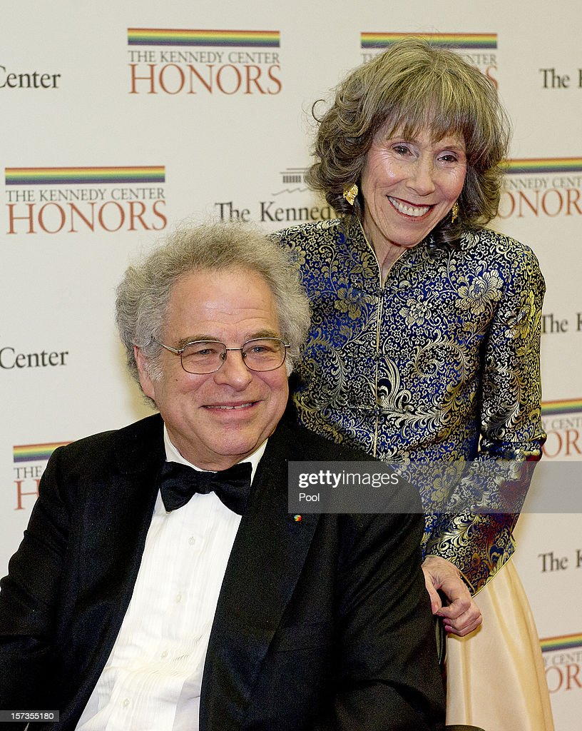 Itzhak Perlman, and his wife, Toby, arrive for the formal Artist's Dinner honoring the recipients of the 2012 Kennedy Center Honors hosted by United States Secretary of State Hillary Rodham Clinton at the U.S. Department of State December 1, 2012 in Washington, DC. The 2012 honorees are Buddy Guy, actor Dustin Hoffman, late-night host David Letterman, dancer Natalia Makarova, and the British rock band Led Zeppelin (Robert Plant, Jimmy Page, and John Paul Jones).