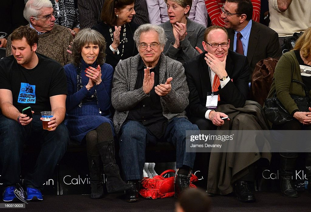 <a gi-track='captionPersonalityLinkClicked' href=/galleries/search?phrase=Itzhak+Perlman&family=editorial&specificpeople=593397 ng-click='$event.stopPropagation()'>Itzhak Perlman</a> (C) attends the Orlando Magic vs Brooklyn Nets game at Barclays Center on January 28, 2013 in the Brooklyn borough of New York City.