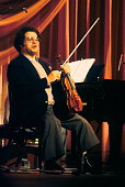 Itzhak Perlman performs on stage at the Royal Variety Performance Theatre Royal Drury Lane London 17th November 1981