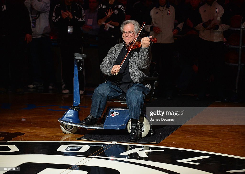 <a gi-track='captionPersonalityLinkClicked' href=/galleries/search?phrase=Itzhak+Perlman&family=editorial&specificpeople=593397 ng-click='$event.stopPropagation()'>Itzhak Perlman</a> performs 'The Star-Spangled Banner' before the Orlando Magic vs Brooklyn Nets game at Barclays Center on January 28, 2013 in the Brooklyn borough of New York City.
