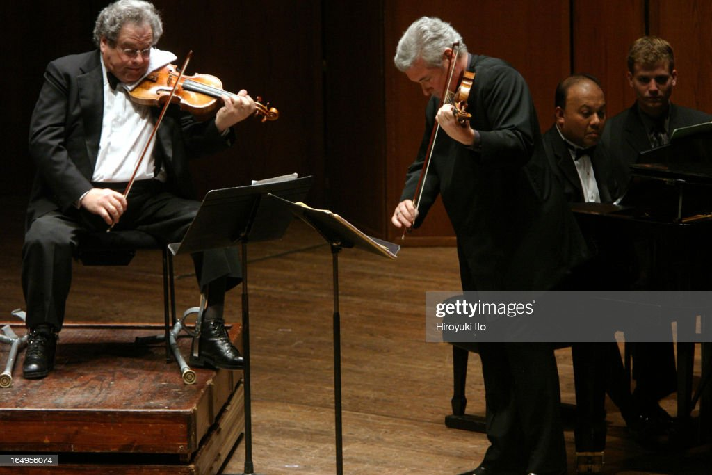 Itzhak Perlman Pinchas Zukerman performing together at Avery Fisher Hall on Tuesday night April 25 2006This imageFrom left Itzhak Perlman Pinchas...
