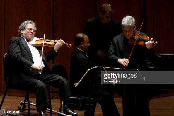 Itzhak Perlman Pinchas Zukerman performing together at Avery Fisher Hall on Tuesday night April 25 2006This imageFrom left Itzhak Perlman Rohan de...