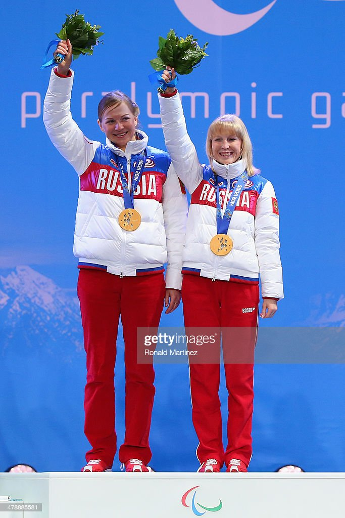Iuliia Budaleeva (R) and guide Tatiana Maltseva (L) celebrate at the medal ceremony for the the Women's 12.5km Visually Impaired Biathlon on day eight of the Sochi 2014 Paralympic Winter Games at Laura Cross-country Ski & Biathlon Center on March 15, 2014 in Sochi, Russia.