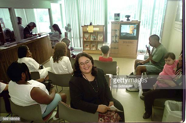 IUniversal#3IS7/17Sylvia Drew Ivie exec director of THE Clinic sits in waiting room among the Medi–Cal patients that the clinic serves Photo Iris...