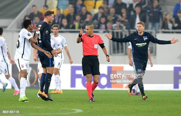 Iury of FC Zorya Luhansk Niklas Stark of Hertha BSC referee Liran Liany and Mitchell Weiser of Hertha BSC during the Europa League group J game...