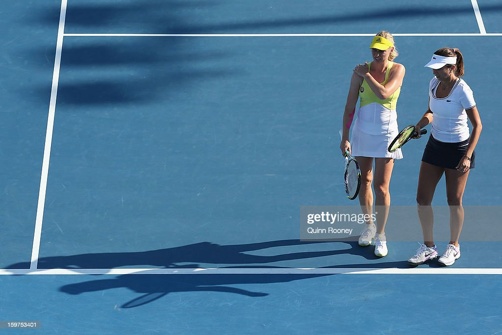 Iva Majoli of Croatia and Barbara Schett Austria talk tactics in their legends doubles match against Martina Navratilova of the United States of America and Martina Hingis of Switzerland during day seven of the 2013 Australian Open at Melbourne Park on January 20, 2013 in Melbourne, Australia.