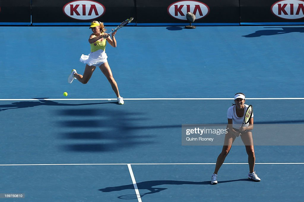 Iva Majoli of Croatia and Barbara Schett of Austria compete in their third round legends doubles match against Martina Hingis of Switzerland and Martina Navratilova of the United States during day seven of the 2013 Australian Open at Melbourne Park on January 20, 2013 in Melbourne, Australia.