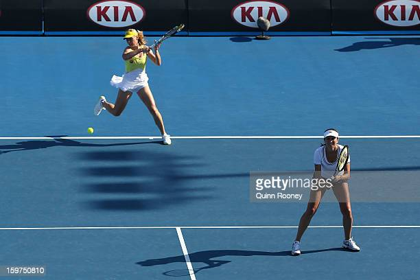 Iva Majoli of Croatia and Barbara Schett of Austria compete in their third round legends doubles match against Martina Hingis of Switzerland and...