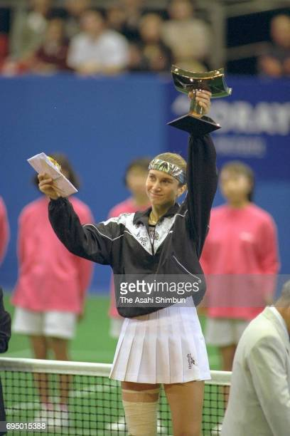 Iva Majoli of Croatia celebrates with the trophy after winning the singles final against Arantxa Sanchez Vicario of Spain during day six of the Toray...
