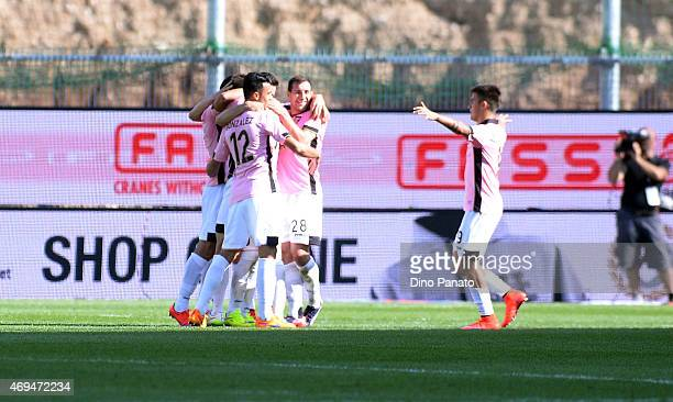 Ivajlo Chocev of US Citta di Palermo is congratulated by team mates after scoring his team's third goal of the game during the Serie A match between...