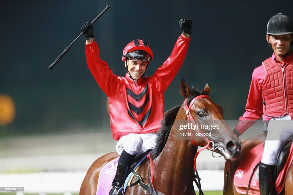 Ivaldo Santana riding Stepitup celebrates after winning the Group 1 Singapore Guineas during Singapore racing at Kranji on May 17, 2013 in Singapore.