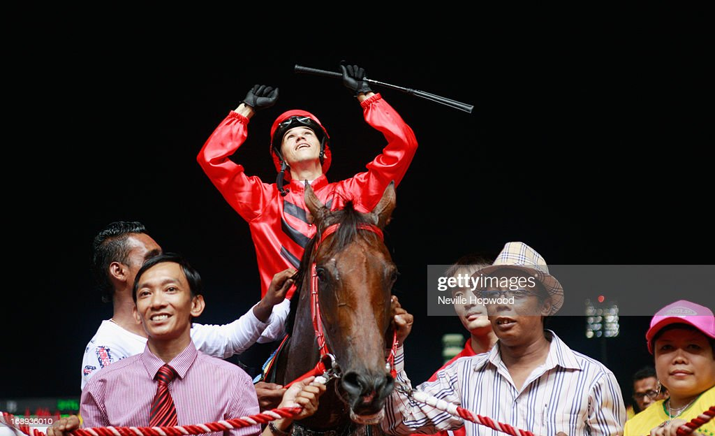 Ivaldo Satana celebrates after winning the Group 1 Singapore Guineas on Stepitup during Singapore racing at Kranji on May 17, 2013 in Singapore.