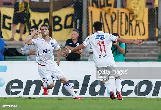 Ivan Alonso of Nacional celebrates after scoring the first goal of his team during a match between Penarol and Nacional as part of 12th round of...