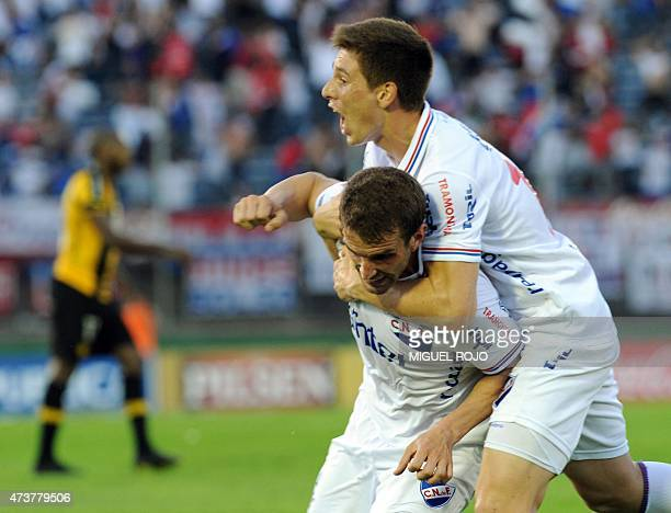 Ivan Alonso of Nacional celebrates with teammate Santiago Romero after scoring against Penarol during the Uruguayan derby football match at the...
