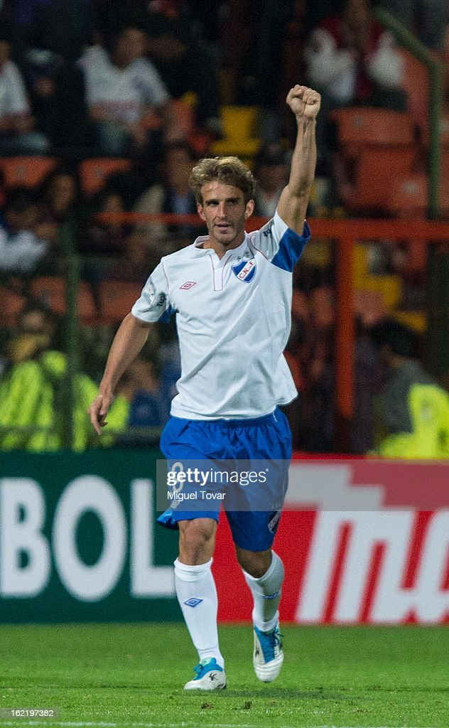 <a gi-track='captionPersonalityLinkClicked' href=/galleries/search?phrase=Ivan+Alonso&family=editorial&specificpeople=2474444 ng-click='$event.stopPropagation()'>Ivan Alonso</a> of Nacional de Uruguay celebrates after scoring during a match between Toluca and Nacional de Uruguay for the Bridgestone Libertadores Cup at Nemesio Diez on February 19, 2013 in Toluca, Mexico.