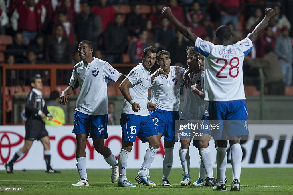 <a gi-track='captionPersonalityLinkClicked' href=/galleries/search?phrase=Ivan+Alonso&family=editorial&specificpeople=2474444 ng-click='$event.stopPropagation()'>Ivan Alonso</a> of Nacional de Uruguay celebrates with his teammates after scoring during a match between Toluca and Nacional de Uruguay for the Bridgestone Libertadores Cup at Nemesio Diez on February 19, 2013 in Toluca, Mexico.