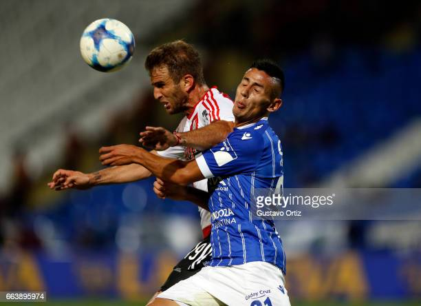 Ivan Alonso of River Plate and Fabricio Angilieri of Godoy Cruz go for a header during the match between Godoy Cruz and River Plate as part of the...