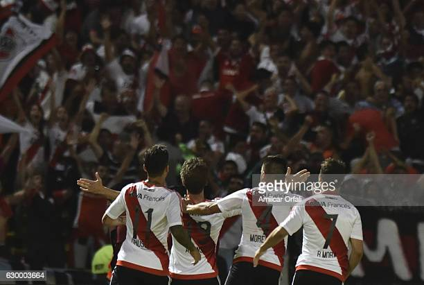 Ivan Alonso of River Plate celebrates with teammates after scoring the fourth goal of his team during a final match between River Plate and Rosario...