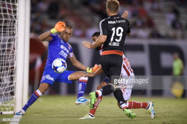 Ivan Alonso of River Plate fights for the ball with Emanuel Britez of Union during a match between River Plate and Union as part of Torneo Primera...