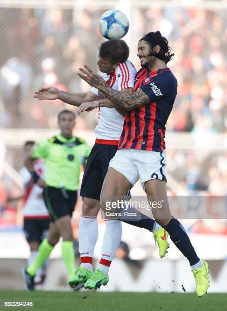 Ivan Alonso of River Plate fights for the ball with Marcos Angeleri of San Lorenzo during a match between San Lorenzo and River Plate as part of...