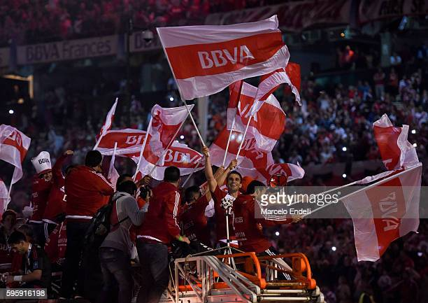 Ivan Alonso of River Plate waves a flag after a second leg match between River Plate and Independiente Santa Fe as part of Recopa Sudamericana 2016...