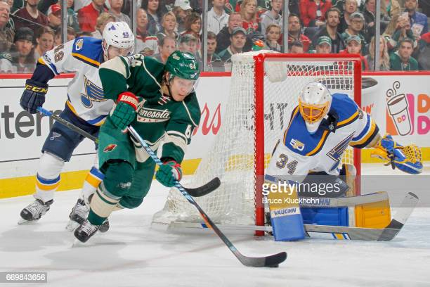 Ivan Barbashev and Jake Allen of the St Louis Blues defend their goal against Mikael Granlund of the Minnesota Wild in Game One of the Western...