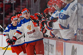 Ivan Barbashev of Team Russia celebrates his goal with teammates on the bench in a quarterfinal round during the 2015 IIHF World Junior Hockey...