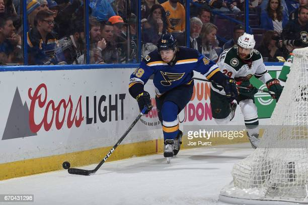 Ivan Barbashev of the St Louis Blues and Jason Pominville of the Minnesota Wild battle for the puck in Game Four of the Western Conference First...