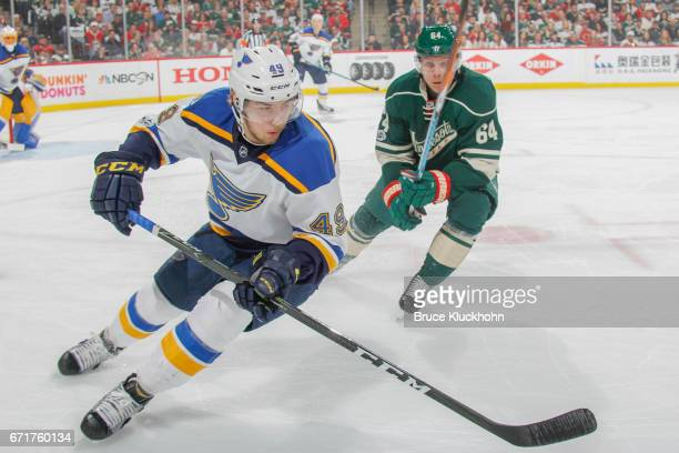 Ivan Barbashev of the St Louis Blues and Mikael Granlund of the Minnesota Wild skate to the puck in Game Two of the Western Conference First Round...