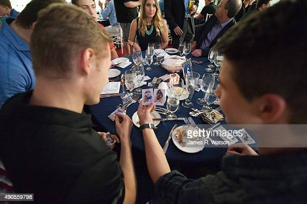 Ivan Barbashev of the St Louis Blues and Nikolay Goldobin of the San Jose Sharks open packs of Upper Deck hockey cards during dinner at the Hockey...