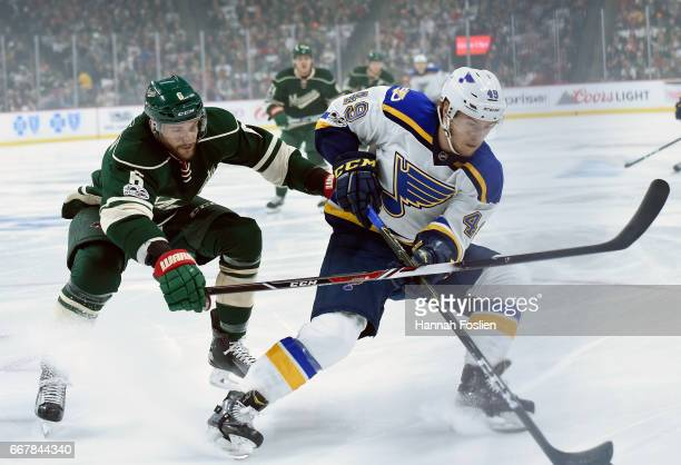 Ivan Barbashev of the St Louis Blues controls the puck against Marco Scandella of the Minnesota Wild during the first period in Game One of the...
