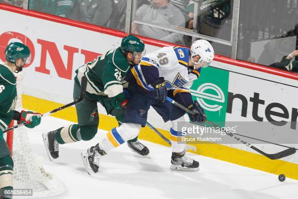 Ivan Barbashev of the St Louis Blues handles the puck along the boards with Jonas Brodin of the Minnesota Wild defending in Game Two of the Western...