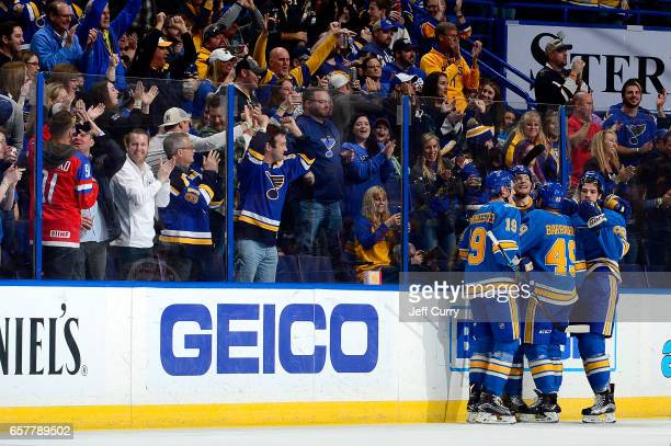 Ivan Barbashev of the St Louis Blues is congratulated by teammates after scoring against the Calgary Flames on March 25 2017 at Scottrade Center in...