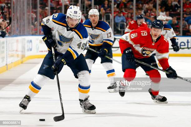 Ivan Barbashev of the St Louis Blues skates with the puck against Michael Matheson of the Florida Panthers at the BBT Center on April 6 2017 in...
