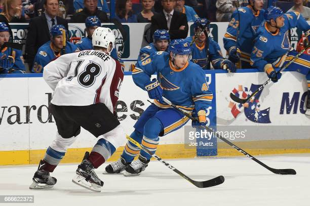 Ivan Barbashev of the St Louis Blues skates with the puck as Cody Goloubef of the Colorado Avalanche defends on April 9 2017 at Scottrade Center in...