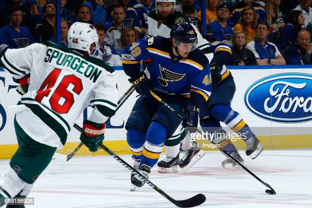 Ivan Barbashev of the St Louis Blues skates with the puck as Jared Spurgeon of the Minnesota Wild defends in Game Three of the Western Conference...