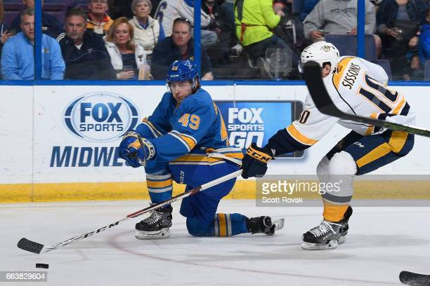 Ivan Barbashev of the St Louis Blues takes a shot as Colton Sissons of the Nashville Predators defends during the game on April 2 2017 at Scottrade...