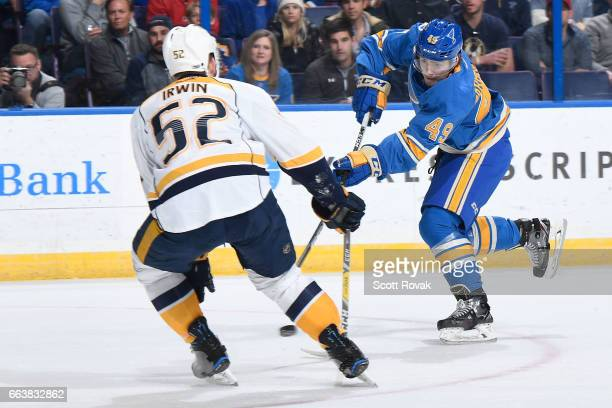 Ivan Barbashev of the St Louis Blues takes a shot as Matt Irwin of the Nashville Predators defends during the game on April 2 2017 at Scottrade...