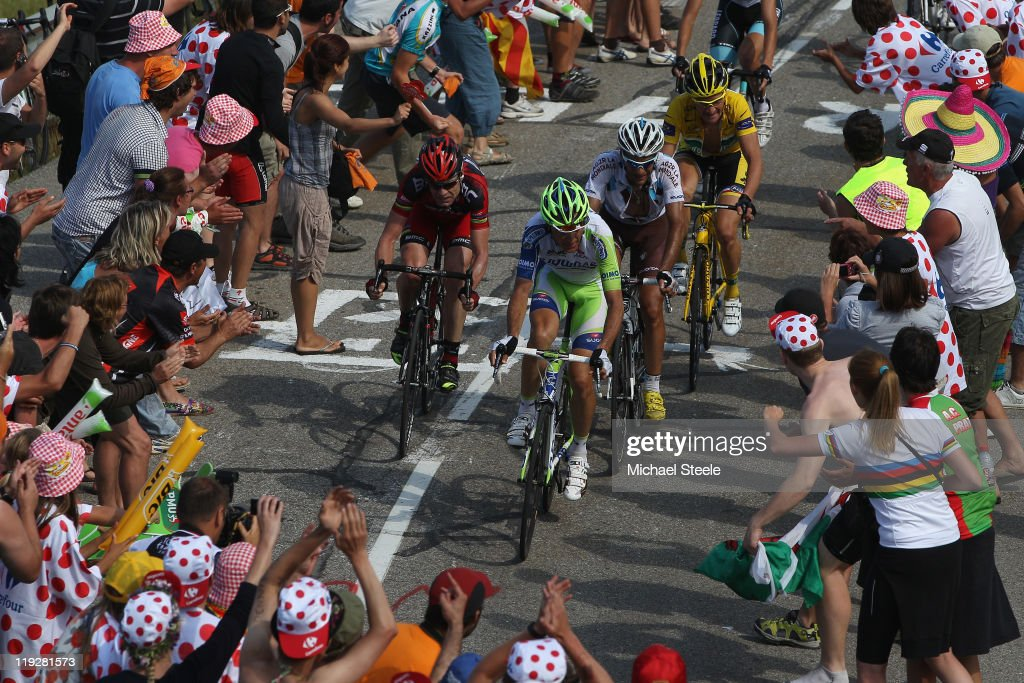Ivan Basso of Italy and team LiquigasCannondale leads the chasing pack from JeanChristophe Peraud of France and team AG2R La MondialeCadel Evans of...