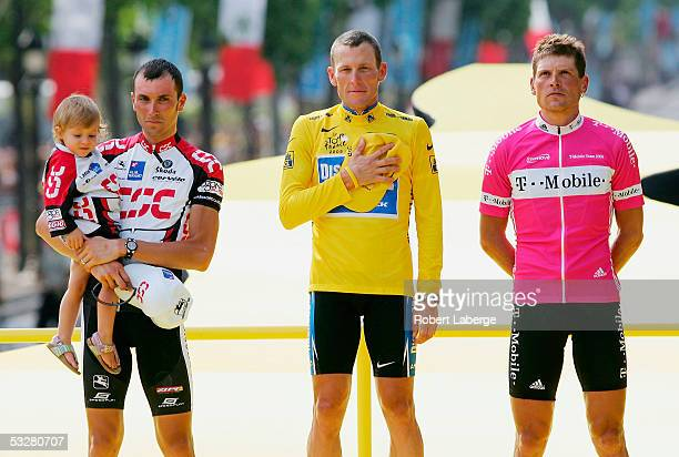 Ivan Basso of Italy from CSC Team Lance Armstrong of the USA riding for the Discovery Channel and Jan Ullrich of Germany from The TMobile Team on the...