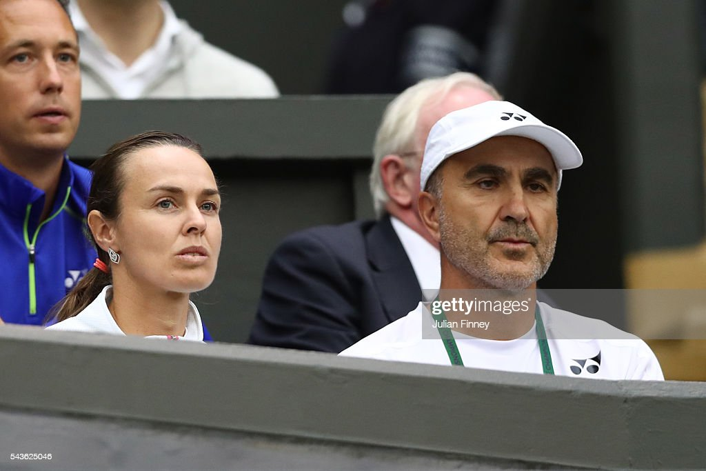 Ivan Bencic the coach of Belinda Bencic and Martina Hingis watch on as Belinda Bencic plays during the Ladies Singles second round match against Tsvetana Pironkova of Bulgaria on day three of the Wimbledon Lawn Tennis Championships at the All England Lawn Tennis and Croquet Club on June 29, 2016 in London, England.