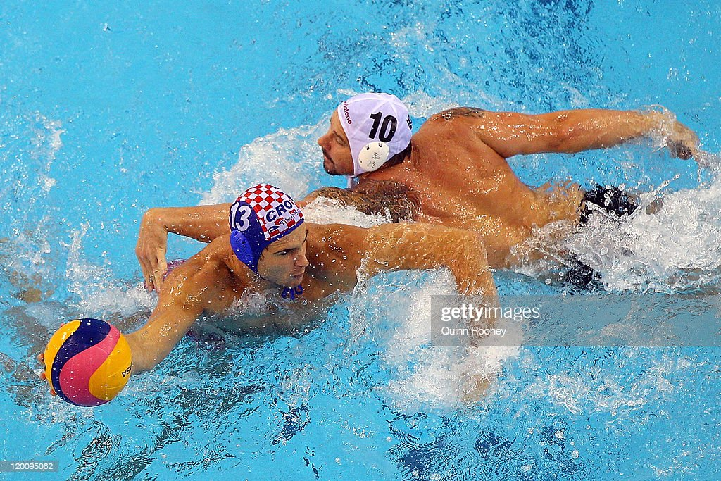 Ivan Buljubasic of Croatia (blue cap) battles with Peter Biros of Hungary (white cap) and in the Men's Water Polo bronze medal match between Hungary and Croatia during Day Fifteen of the 14th FINA World Championships at the Oriental Sports Center on July 30, 2011 in Shanghai, China.