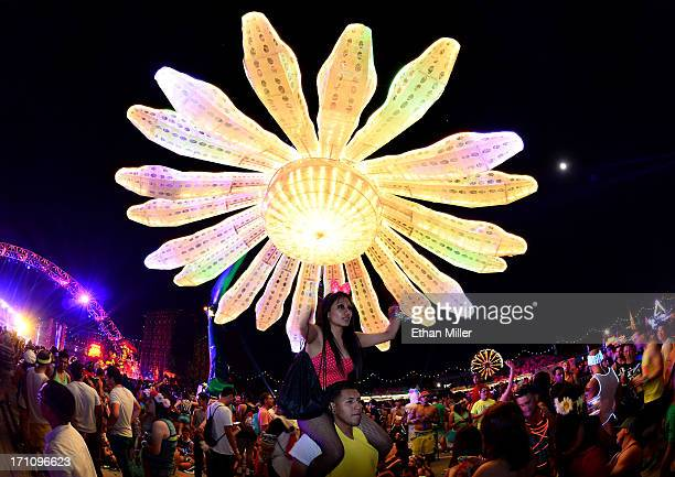 Ivan Camargo of California holds up his wife Lily Camargo during the 17th annual Electric Daisy Carnival at Las Vegas Motor Speedway on June 21 2013...