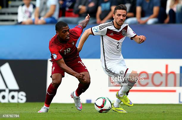 Ivan Cavaleiro of Portugal and Julian Korb of Germany battle for the ball during the UEFA European Under21 semi final match Between Portugal and...