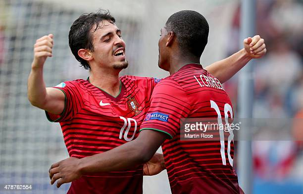 Ivan Cavaleiro of Portugal celebrate with team mate Bernardo Silva after scoring the 3rd goal during the UEFA European Under21 semi final match...