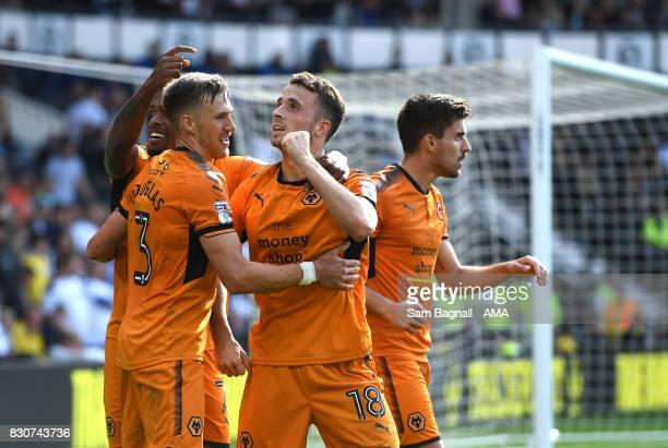 Ivan Cavaleiro of Wolverhampton Wanderers celebrates after scoring a goal to make it 02 with Diogo Jota of Wolverhampton Wanderers during the Sky Bet...